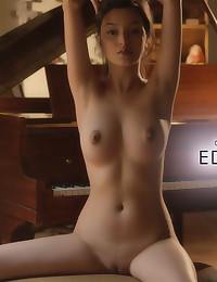 Eden Arya takes a break from the piano and plays with something else
