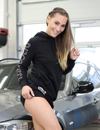 Beautiful babe with very fit body, tight ass, long legs and round perky tits most of all loves two things in this world – expensive cars and naughty sex. The babe is eager to fuck but no one is around in the car shop except her and a luxury auto. It doesn't stop the hottie from stripping down and rubbing her wet pussy without any shame. The intense masturbation makes this beautiful minx cum from the mind-blowing orgasm.