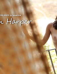 Dillion Harper slowly strips down by an open window