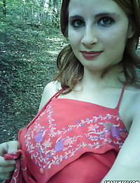 Busty girlfriend takes selfshot pictures outdoors of her big perfect tits as she strips naked