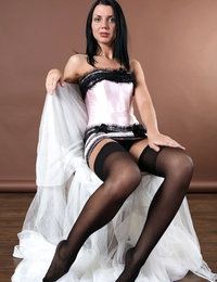 Glamorous model Macy in her black stockings looks like a queen