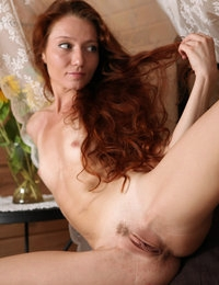 Frisky redhead babe Kesy is proud to show her tiny tits and twat