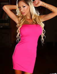 Tattooed Alluring Vixen babe Chanel shows off her huge boobs in a skin tight hot pink dress